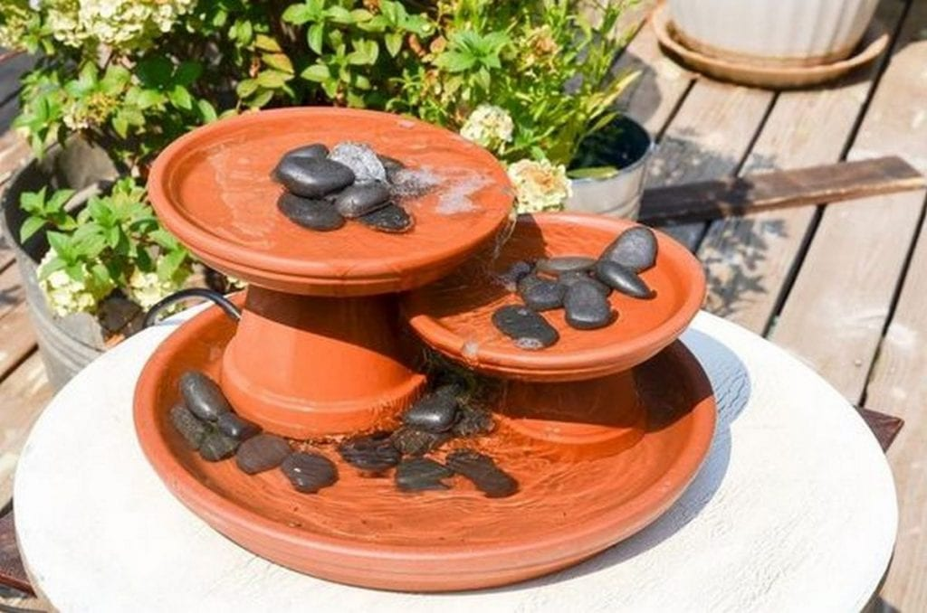 This terra cotta fountain serves the same purpose as the other water fountains minus the hefty price tag.