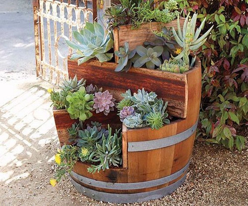 Simple saw a wine barrel up into several tiers for a beautiful garden piece.
