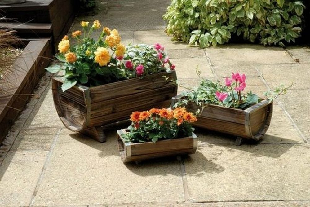 You can turn old wine barrels into these beautiful planters!