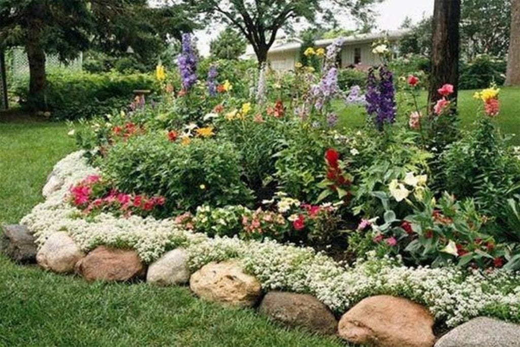 There are lots and lots of ways you can easily put in a garden bed edging.
