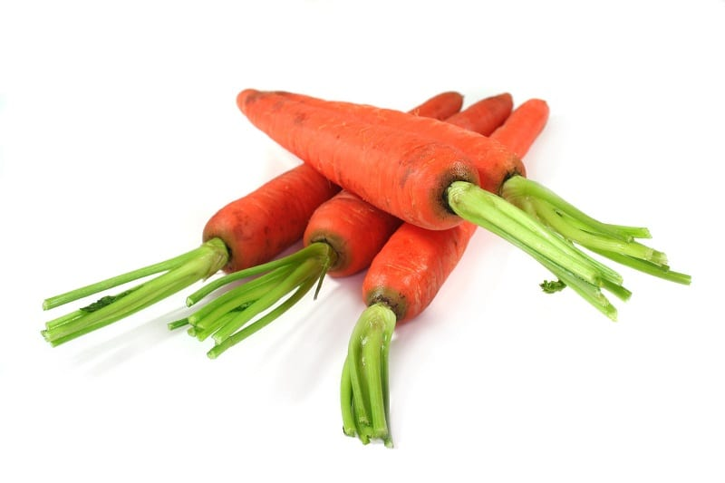While your carrots will not 'grow' in the winter, they will stay fresh.