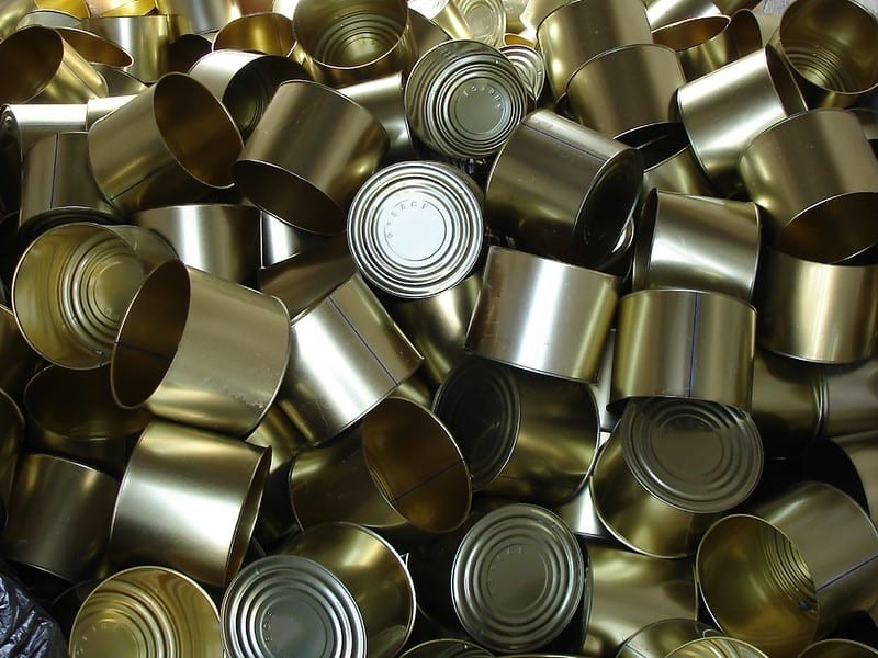 Hanging up pie tins and aluminum cans creates both an unusual visual and sound.