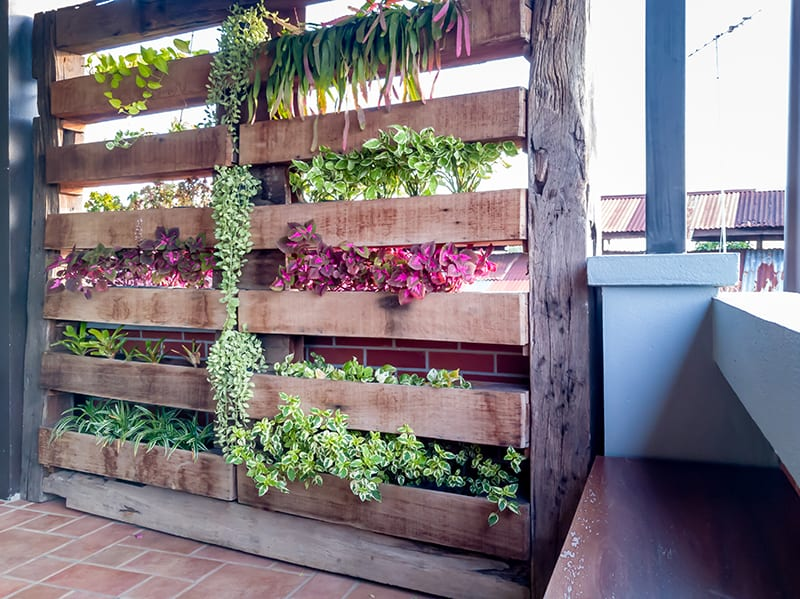 Stacking planters vertically is practical and eye-catching