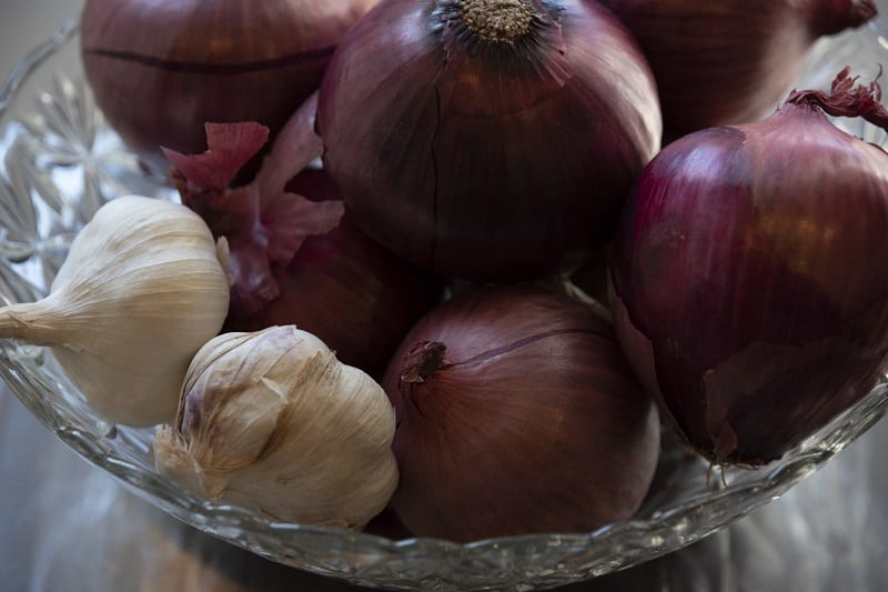 Onion and garlic grow beneath the surface of the ground and prefer a sandy habitat.