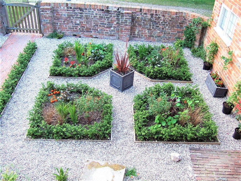 You can build on the sheer beauty of herbs in a formal parterre.