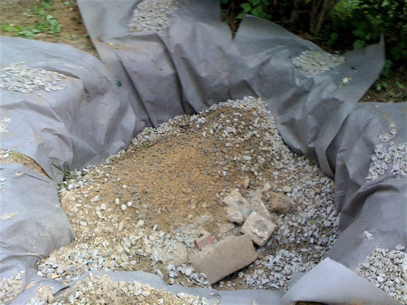 Also known as a gravel pit, a drywell is simply a large hole in the ground filled with gravel.