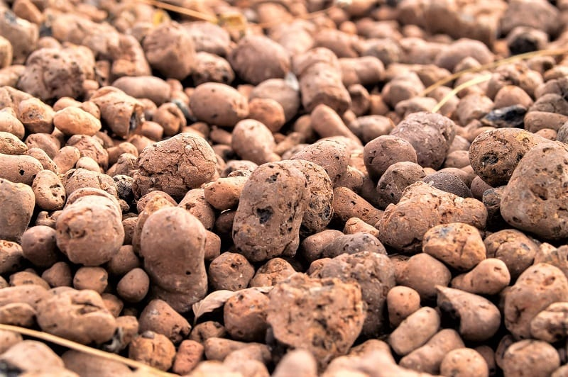 Clay pebbles -or hydrotons - are pH neutral. They don't affect the water. They also hold moisture well.