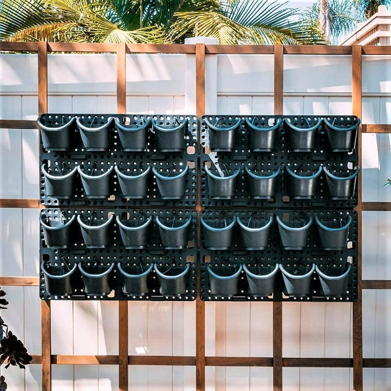 The Watex Pro System Vertical Wall Planter, on the other hand, comes with its own watering system. This planter is made from recycled plastic and consists of 32 pots arrayed on four wall panels.